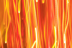 Abstract lines of orange, yellow, and red lights. Stock Image