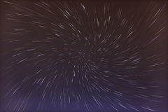 Abstract long exposure of vortex star trails background Stock Photo