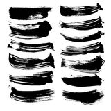 Abstract long smears from black thick paint Stock Image