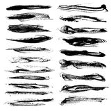 Abstract long textured strokes of black paint  on white Royalty Free Stock Photo