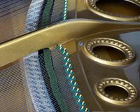 Snares mutes and hammers inside a grand piano. Abstract look into the inside of a bechstein grand piano Royalty Free Stock Photography