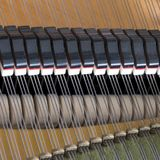Snares mutes and hammers inside a grand piano. Abstract look into the inside of a bechstein grand piano Stock Images