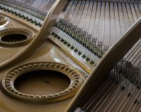 Snares mutes and hammers inside a grand piano. Abstract look into the inside of a bechstein grand piano Royalty Free Stock Photos