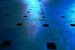 Abstract look of Metal Bench. With blue night light royalty free stock photo