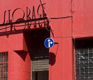 Abstract look at red painted building with storage sign Stock Image