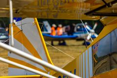 Abstract looking picture of the rear part of a yellow and white striped antique small plane. royalty free stock image
