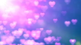 Abstract Loopable Background, flying hearts and particles stock footage