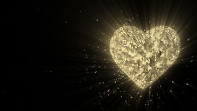 Abstract looped animated background: Rotating luminous 3d golden heart formed pieces and cubes of gold spinning with stray pieces. stock video