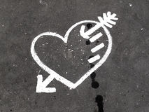 Abstract love symbol on pavement Stock Images