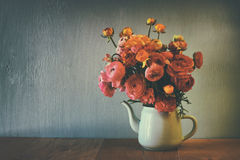 Abstract low key image of summer bouquet of flowers on the wooden table. vintage filtered image Royalty Free Stock Images
