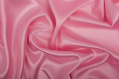 Pink satin fabric as background. stock photography