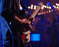 Guitarist live playing solo in focus. Blurred background royalty free stock photos