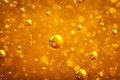 Abstract macro honey bubbles closeup in bright amber color. The texture of the honey. Healthy food concept. Diet. Selective focus. Horizontal stock images