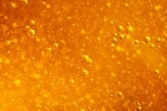 Abstract macro honey bubbles closeup in bright amber color. The texture of the honey. Healthy food concept. Diet. Selective focus. Horizontal royalty free stock photography