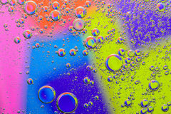 Abstract macro of oil mixed with water on colorful Stock Photography