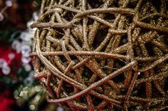 Abstract macro view of Christmas sequin gold glitter twine ball ornament. Intentional selective focus for artistic effect. Abstract macro view of Christmas stock photography