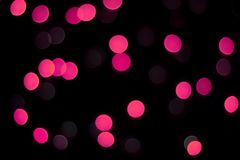 Abstract magenta bokeh texture on black background. stock photo