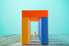 Abstract man into the colorful wooden corridor Stock Photo