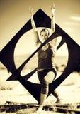 Abstract Mandala Yoga. Woman in the yoga pose warrior in an abstract mandala shape Royalty Free Stock Photos