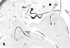 Abstract marble background. Paper and mix of flowing ink. Gray and black color mix. Stock Photo