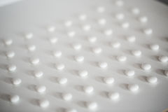 Abstract Medical background. White tablets on a white. Abstract Medical background Stock Image