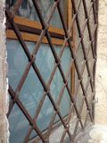 Abstract medieval barred window Royalty Free Stock Photography