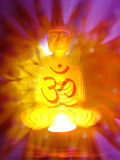 Abstract Meditation Background. An abstract meditation background of the holy 'OM' on the backdrop of the Buddha on a divine light Stock Image