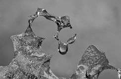 Abstract melting ice with grey background. And one drop of clear and cold water with shining star Stock Images