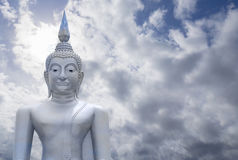 Abstract merge layer sky on image of Buddha with blue sky and cloud in background, light effect added , prachuapkhirikhan. Thailand,filtered image,copy space royalty free stock image