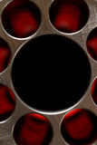 Abstract metal. Background with holes and dark center Stock Photos
