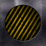 Abstract metal background. Metallic background with circle cut out and yellow and black grunge stripes Royalty Free Stock Photo