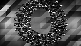 Abstract metal balls moving in a circle on grey geometrical background, monochrome. Rotating circle of metall spheres