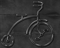 Abstract metal bicycle on black textured background Stock Photos