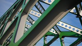 Abstract metal construction. Details of the metallic green bridge in Bratislava, Slovakia. Industrial construction. Stock Images