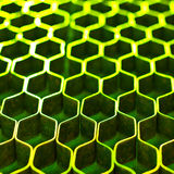 Abstract metal honeycomb structure. Abstract hexagonal structure with shallow dof. Green metal honeycomb mesh. Technology concept Royalty Free Stock Photo