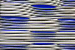 Abstract metal pipes blue background Stock Photography