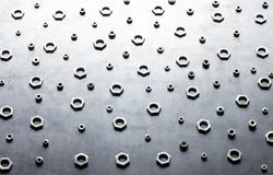 Abstract metal screw nuts background Royalty Free Stock Image