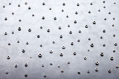 Abstract metal screw nuts background Stock Photos