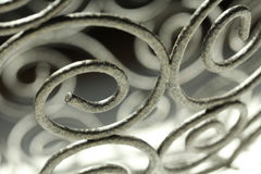 Abstract Metal Scrolls with Shadows. A metal scroll makes an abstract shadow design Royalty Free Stock Photography