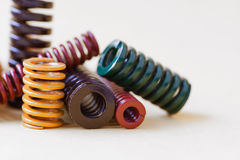 Abstract metal springs colorful steel spirals coil with different hardness flexibility sizes. gray background, soft. Focus shallow depth of field Stock Photos
