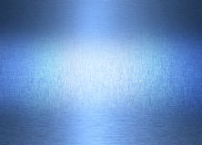 Abstract Metal Stainless Steel Background. A textured metal background with highlights, brushed patterns and a blue tint Royalty Free Stock Image