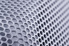 Abstract metal texture. Curved metal sheet perforated texture Stock Images