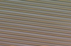 Abstract metallic background oblique lines texture ribbed beige. Brown palette Stock Photography