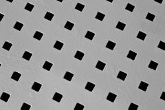 Abstract metallic background with square holes, photo Stock Photography