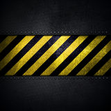 Abstract metallic background with yellow and black warning strip Royalty Free Stock Photography