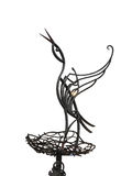 Abstract metallic forged stork on nest isolated over white Stock Photography