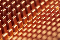 Abstract metallic pattern. Abstract macro background with golden repetitive metal teeth pattern with shallow depth of field Royalty Free Stock Photos