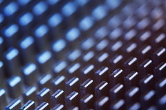 Abstract metallic pattern. Abstract macro background with repetitive metal teeth pattern with shallow depth of field Stock Photo