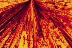 Abstract micrograph of bright red and orange pattern of lysine c. Abstract micrograph of a radiating shower of orange and red lysine crystals on a microscope stock illustration
