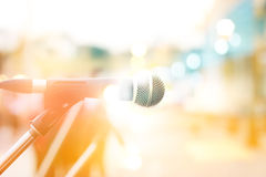 Abstract microphone on street walk in the city, pastel and blur. Concept Stock Photo